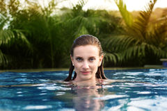 Sexy woman swimming in pool Royalty Free Stock Photography