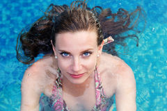 Sexy woman swimming in pool Royalty Free Stock Photos