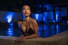 Sexy woman at the swimming pool in evening time Royalty Free Stock Images