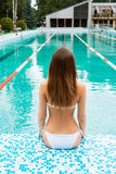Sexy woman in a swimsuit next to a swimming pool Stock Photography