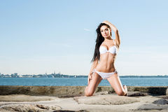 Sexy woman in a swimsuit posing outdoors Stock Images