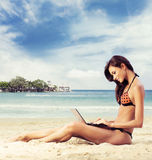 woman in a swimsuit working on a laptop Royalty Free Stock Images