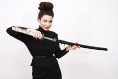 Sexy woman with sword Stock Photos