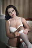 Sexy woman take off white stockings Stock Photo