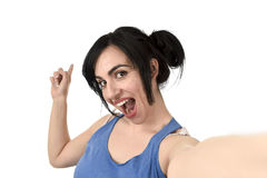 woman taking selfie photo with stick and mobile phone camera posing happy Royalty Free Stock Image
