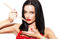 Sexy woman taste meal by wooden spoon Stock Photos