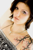 Sexy woman with tattoo in dress Royalty Free Stock Image
