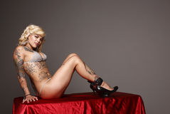 Sexy woman with tattoos Royalty Free Stock Photography
