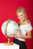 Sexy woman teacher with globe Royalty Free Stock Photo