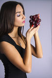 Sexy woman with Temptation winery grape Stock Photo