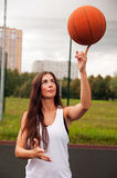 Sexy Woman Throw Basketball Stock Photography