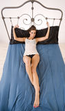 Sexy woman handcuffed bedframe cast iron Royalty Free Stock Photography