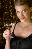 Sexy woman toasting with glass of champagne. In front of out of focus Christmas lights Royalty Free Stock Photography