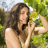 Sexy woman touching a bunch of grapes Royalty Free Stock Image