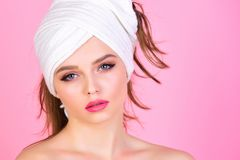 Woman with towel on head after shower. Fashion and beauty spa. Housewife has makeup with towel or headscarf. Morning after bath washing and hair clean. Girl stock photography