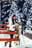 woman travel with camera in snowy forest Royalty Free Stock Photos