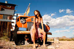 Sexy woman with truck. Sexy woman posing on a truck Stock Photography
