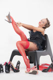 woman trying on high heeled shoes Royalty Free Stock Image