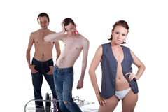 Sexy woman and two men Royalty Free Stock Image