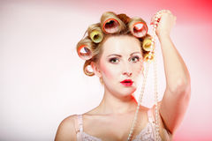 Sexy woman in underwear curlers with beads Stock Photo