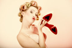 Sexy woman in underwear curlers with shoes Royalty Free Stock Photography