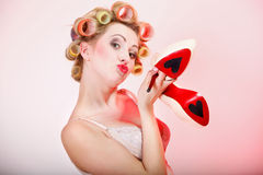 Sexy woman in underwear curlers with shoes Royalty Free Stock Photos