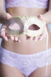 Sexy woman in underwear holding a mask. Sexy woman in sexy underwear holding a mask in hands Stock Photography