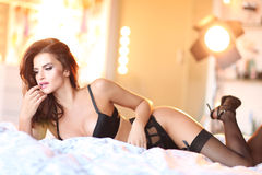 Sexy woman in underwear lying on bed Stock Images