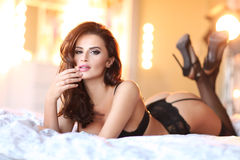 Sexy woman in underwear lying on bed Stock Image