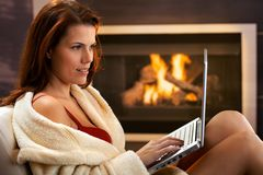 Sexy woman using computer in winter Stock Images