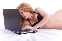 Sexy woman using laptop computer. Royalty Free Stock Image