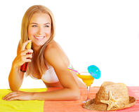 woman using sunscreen Royalty Free Stock Photography