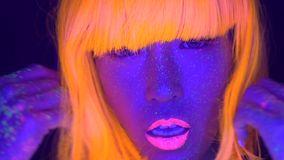 woman with UV fluorescent face and body makeup stock video