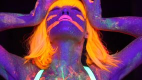 woman with UV fluorescent face and body makeup stock video footage