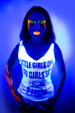 Sexy woman uv light neon make up beauty. Creative colorful makeup neon, glowing painting on face ultraviolet picture, shiny orange fire on blue body. Sexy girl Royalty Free Stock Photos