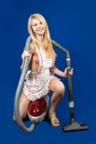 Sexy Woman with vacuum cleaner Royalty Free Stock Images