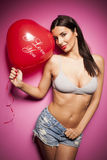 Sexy woman with valentines day balloon on pink background Royalty Free Stock Image