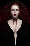 Sexy woman vampire in black dress Stock Image