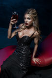 Sexy woman vampire in black dress Royalty Free Stock Photos