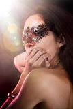 Sexy woman with  venetian mask, red light Royalty Free Stock Photos