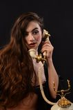 Sexy Woman on Vintage phone Stock Photos