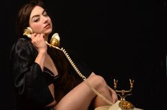 Sexy Woman on Vintage phone Royalty Free Stock Image