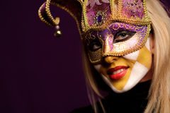 woman in violet party mask Stock Photos