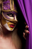 Sexy woman in violet party mask Stock Images