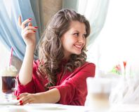 Sexy woman waiting for someone in a cafe. Sexy woman waiting for someone in a restaurant Stock Images