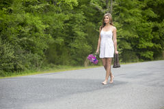 woman walking in barefeet Stock Images