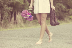 woman walking in barefeet Royalty Free Stock Image
