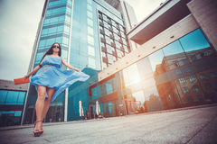 Sexy woman is walking in the modern city Stock Photography