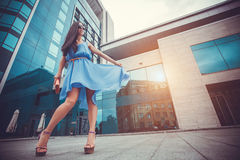 Sexy woman is walking in the modern city Royalty Free Stock Photography