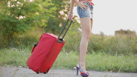 Sexy Woman Walking With Red Suitcase stock footage